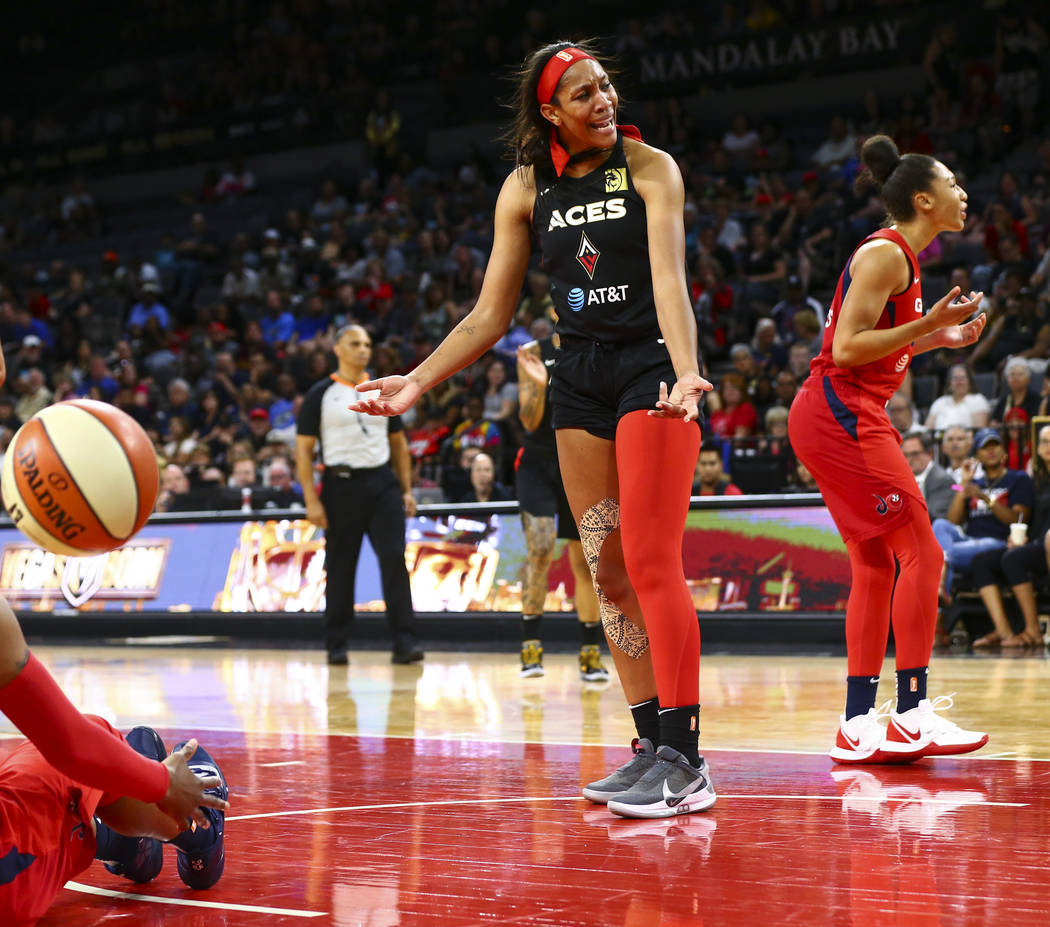Las Vegas Aces center A'ja Wilson (22) reacts after getting fouled by a Washington Mystics play ...