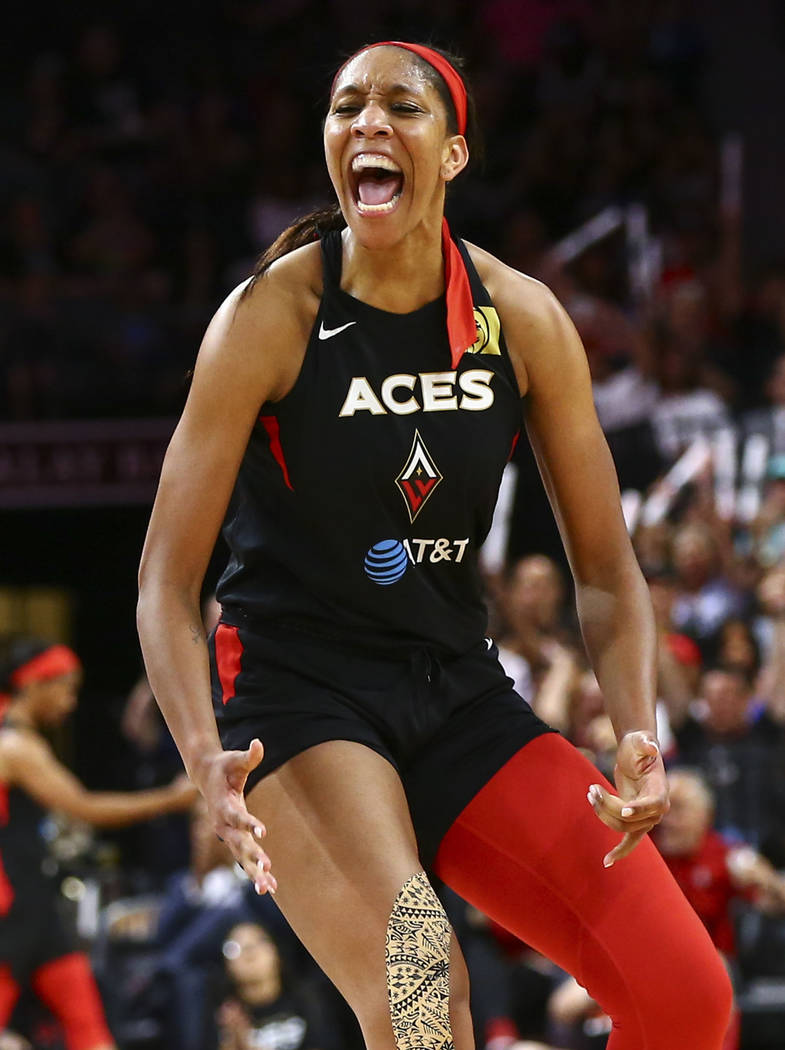 Las Vegas Aces center A'ja Wilson (22) reacts after drawing a foul and scoring against the Wash ...