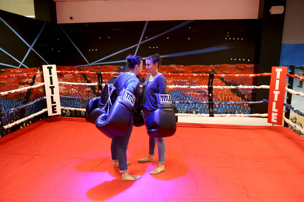 Jamie Vincek, left, and her twin sister Brandie Vincek face off with oversized gloves in the bo ...