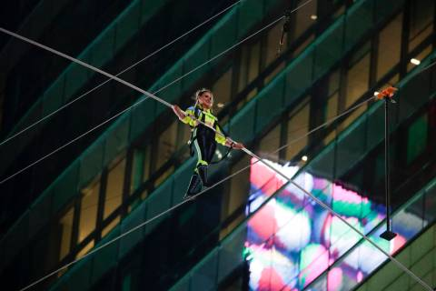 Aerialist Lijana Wallenda walks on a high wire above Times Square, Sunday, June 23, 2019, in Ne ...