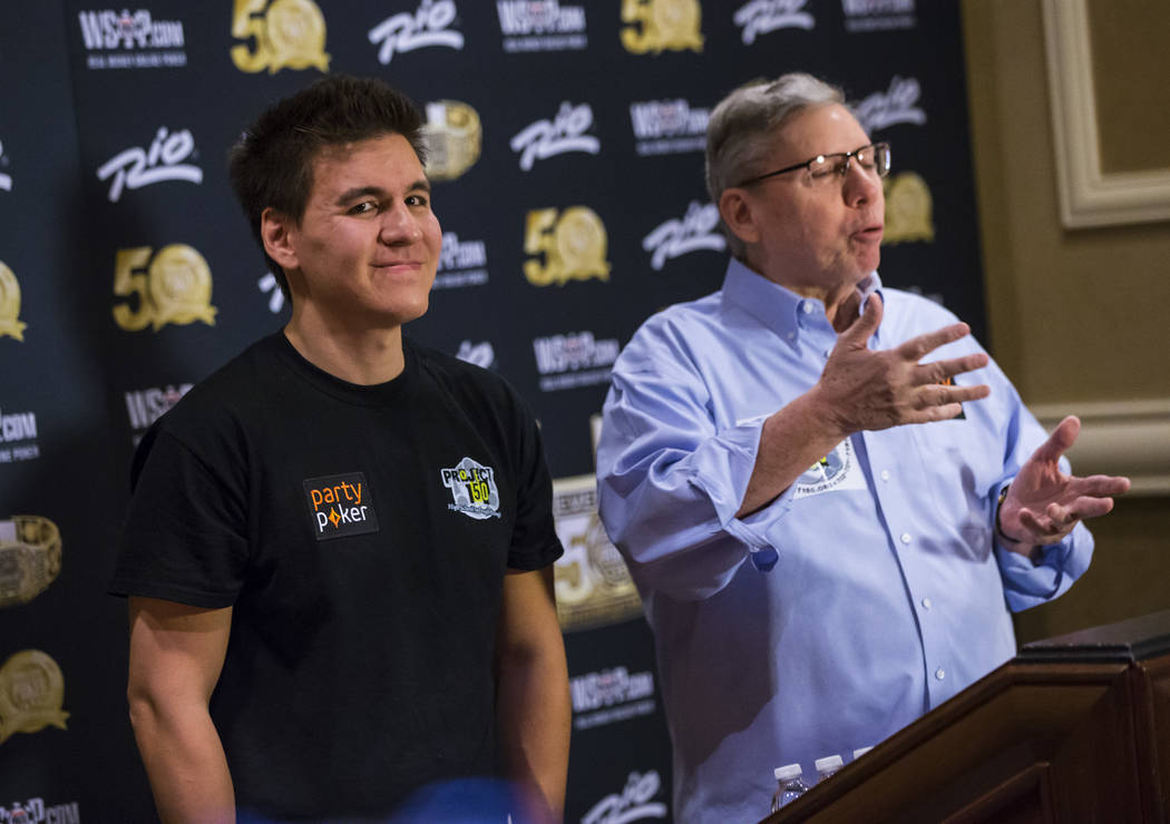 "Las Vegas resident and ""Jeopardy!"" sensation James Holzhauer, left, looks on as Poker ..."