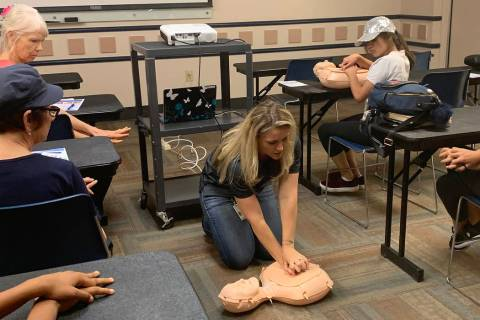 Leslie Shaffer shows attendees at the Heart Health and Hands Only CPR class at the Summerlin Li ...