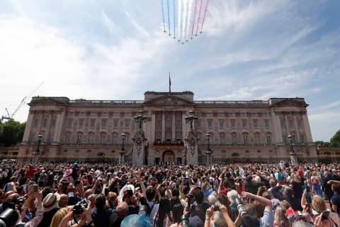 FILE - In this Saturday, June 9, 2018 file photo, Red Arrows fly over Buckingham Palace to atte ...