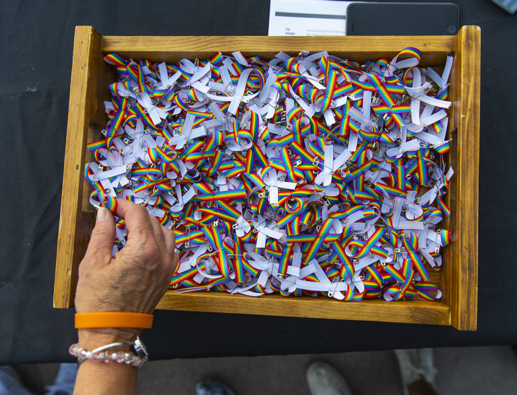 Tiny rainbow bows are free for the taking in the Pride info area beside the main concourse duri ...