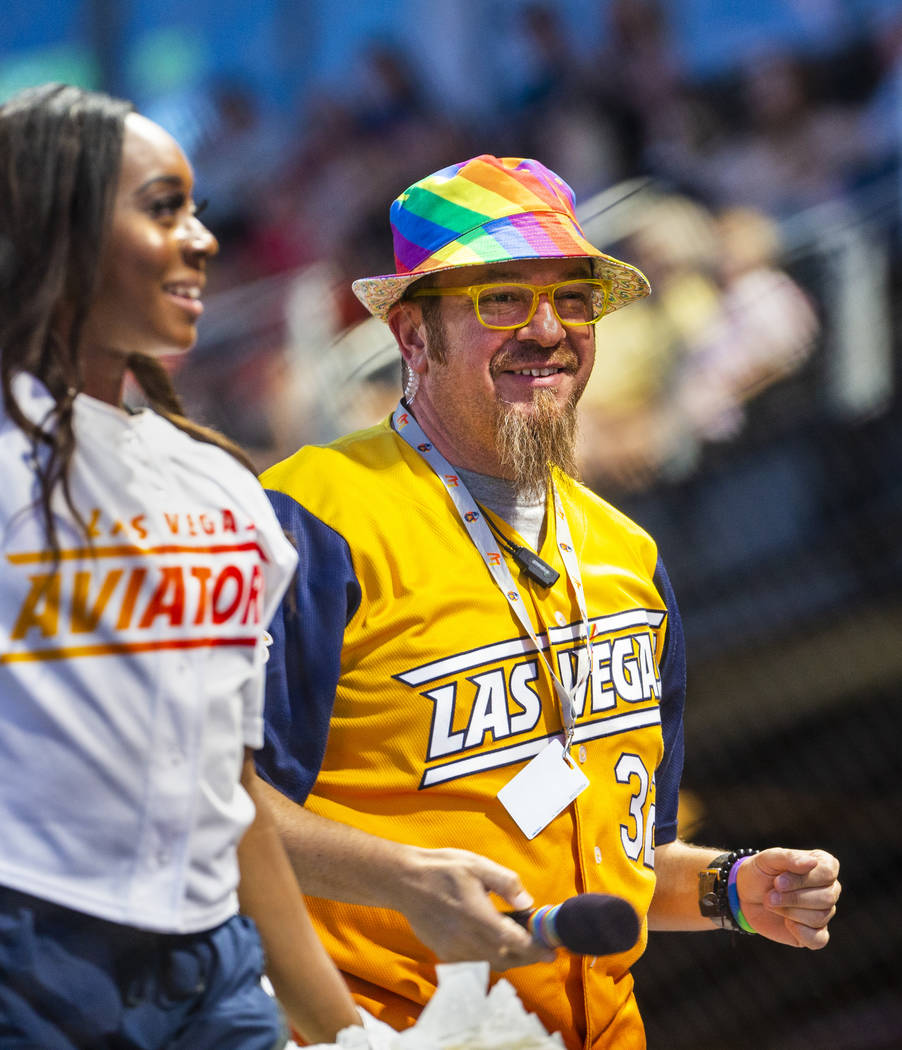 Aviators on-field emcee Andy Martello sports a rainbow hat while working the crowd during Pride ...