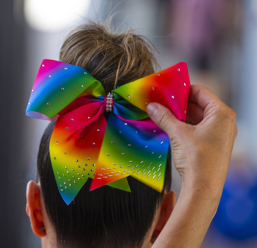 An Aviators fan has her rainbow bow adjusted during Pride Night at the Las Vegas Ballpark on Mo ...