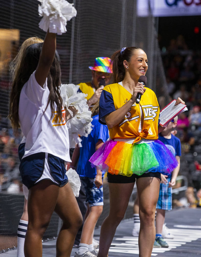 Aviators on-field emcee Katie Greener sports a rainbow tutu while working the crowd during Prid ...