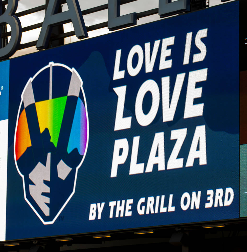 Even the Aviator logo is awash in rainbow colors on the scoreboard during Pride Night at the La ...