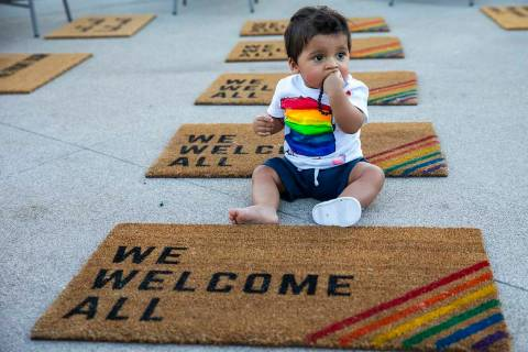 Adan Darun, 11 months old, relaxes among welcome mats near the main concourse during Pride Nigh ...