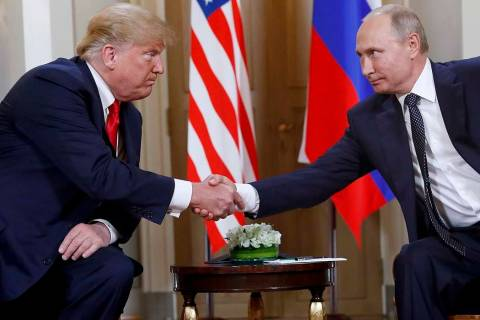In a July 16, 2018, file photo, U.S. President Donald Trump, left, and Russian President Vladim ...