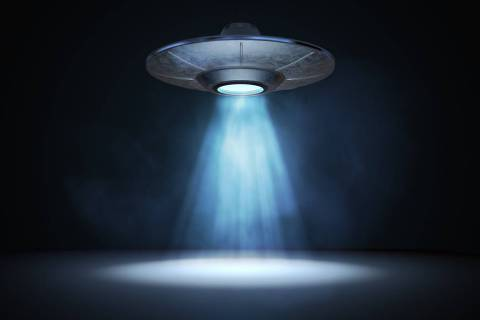 A 3D rendered illustration of a light beam from a flying UFO. (Getty Images)
