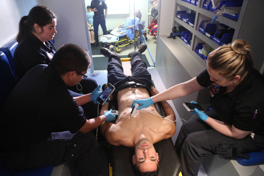 Paramedic student Thomas Vince, center, receives an ultrasound demonstration from fellow parame ...