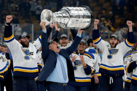 St. Louis Blues head coach Craig Berube carries the Stanley Cup after the Blues defeated the Bo ...