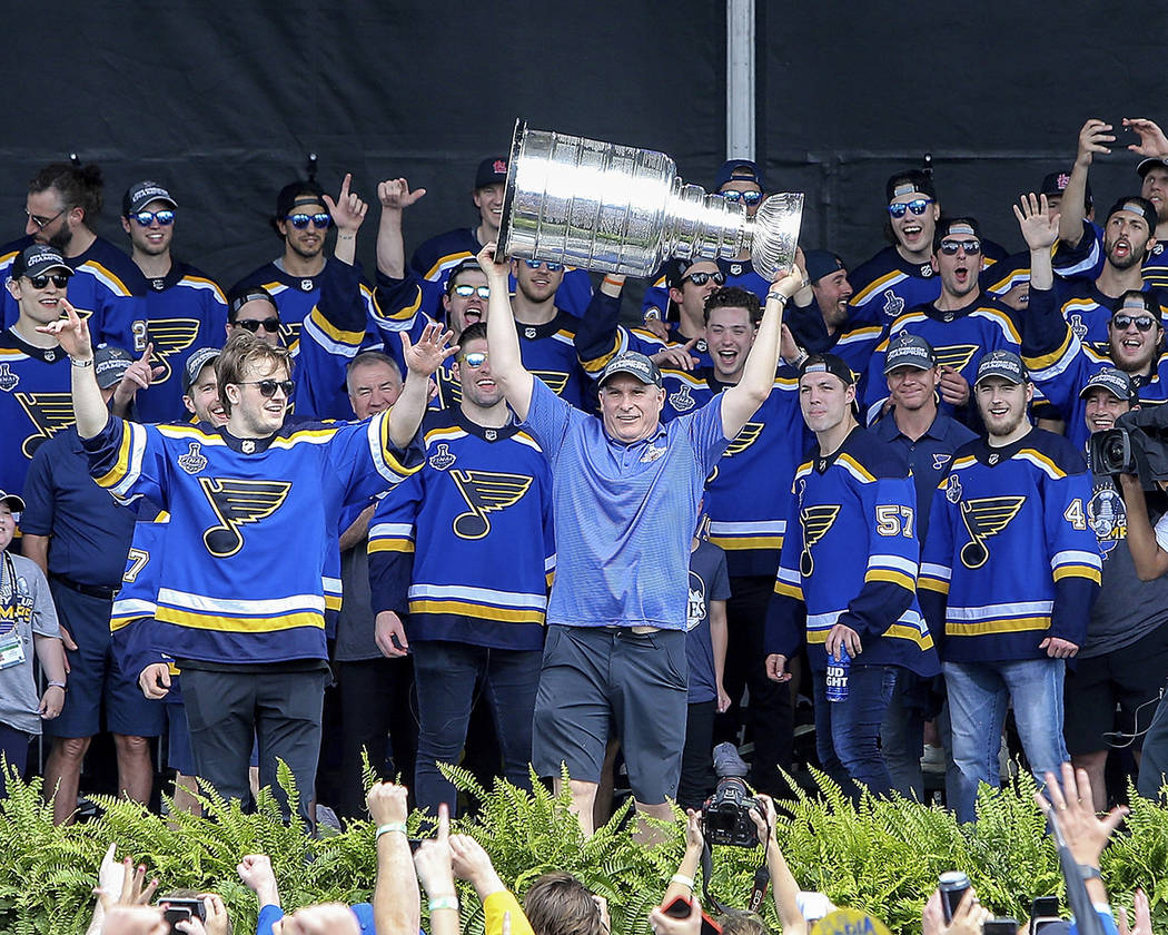 St. Louis Blues head coach Craig Berube holds the Stanley Cup overhead during the NHL hockey St ...