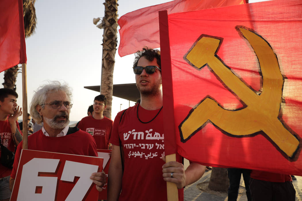 People protest against the conference in Bahrain, which focuses on the economic portion of the ...