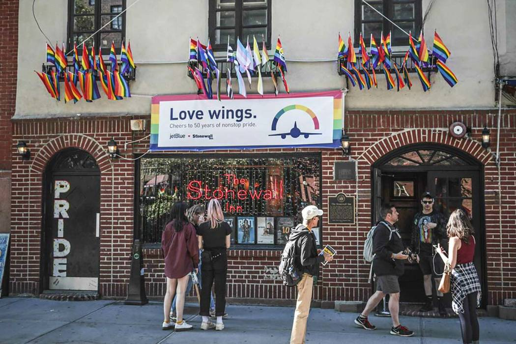 Pride flags and pride colors display on the Stonewall Inn bar on June 3, 2019, marking the sit ...