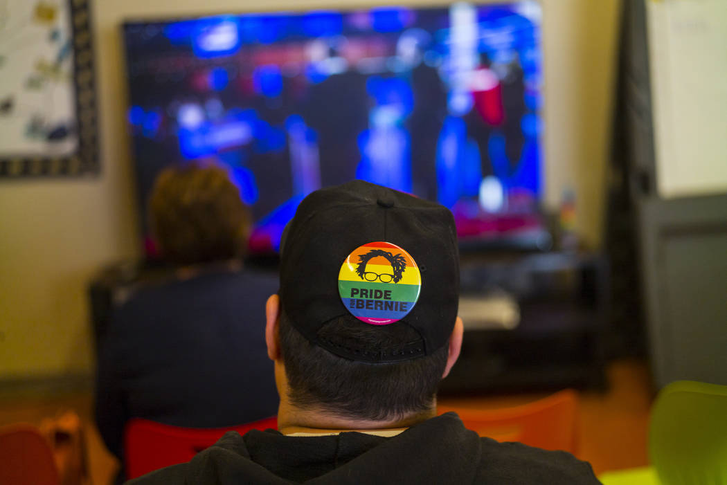 A Bernie Sanders supporter watches the Democratic presidential debate during a watch party held ...