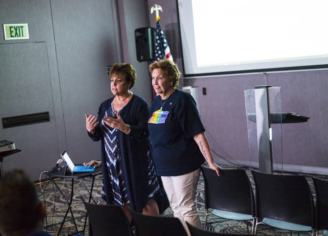 Marla Turner, left, speaks alongside Donna West, chair of the Clark County Democratic Party, be ...