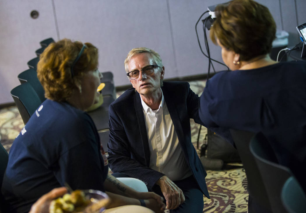 Steven Tomlinson, president of the Stonewall Democratic Club of Southern Nevada, talks with Don ...
