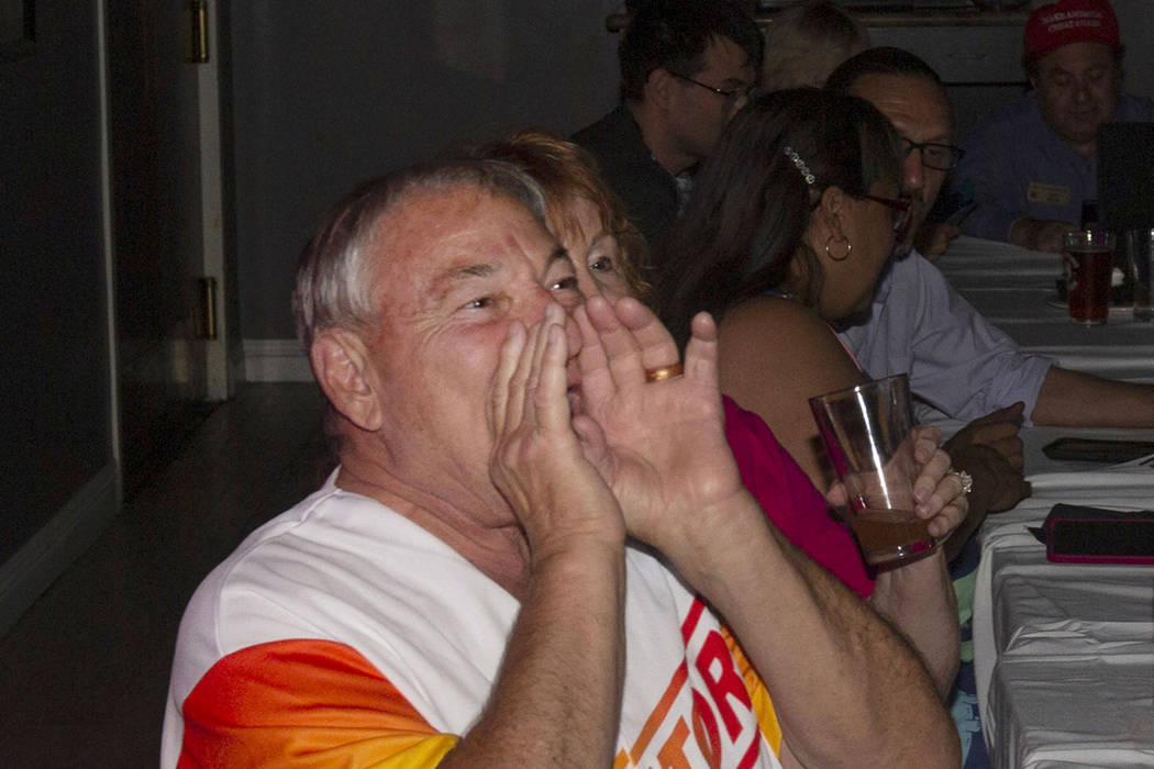 James Larocca, 69, boos while watching a Democratic primary debate during a watch party held by ...