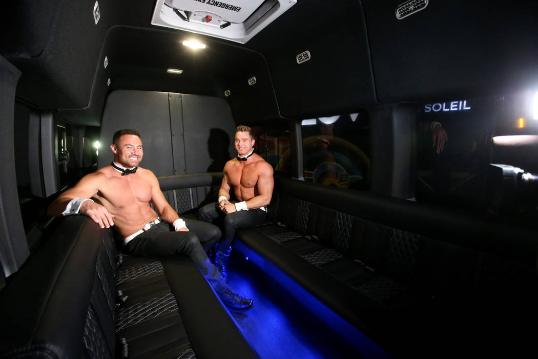 Chippendales Jim Rhodes, left, and Chaz Vorrias show an 11-passenger shuttle in the South Hall ...