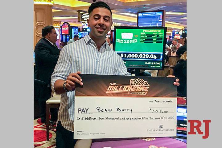 Sean Barry of Ohio shows off his winnings after connecting on the Millionaire Progressive on Fr ...