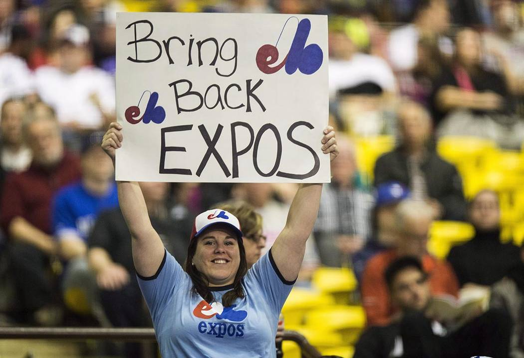 FILE - In this April 3, 2015, file photo, a fan holds up a sign during a pregame ceremony as th ...