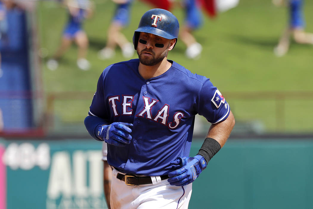 Texas Rangers' Joey Gallo rounds the bases after hitting a two-run home run off of Kansas City ...