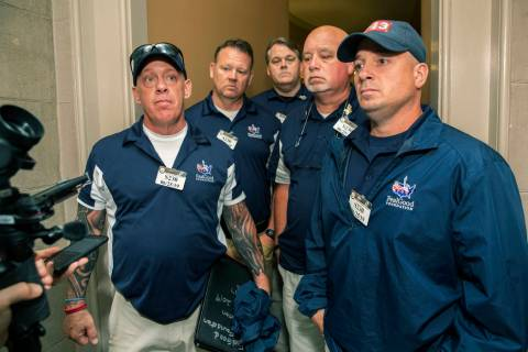 Sept. 11 first responders John Feal, left, Ret. Lt. Michael O'Connell, right, and other first r ...