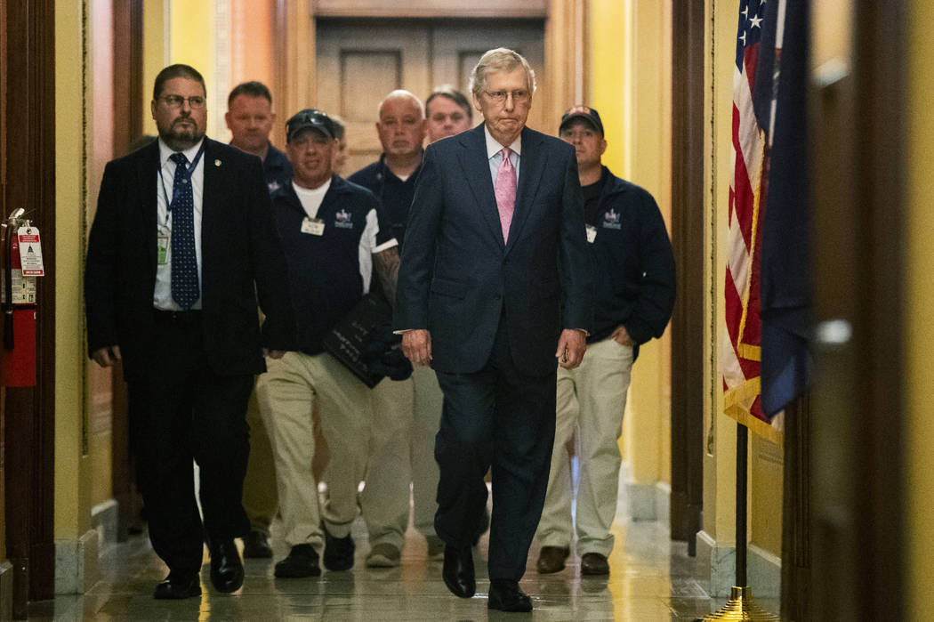 Senate Majority Leader Mitch McConnell walks with Sept. 11 first responders John Feal, second f ...