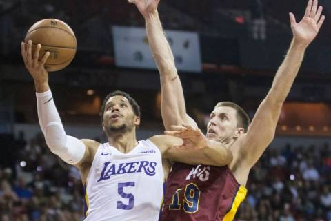 Los Angeles Lakers guard Josh Hart (5) drives past Cleveland Cavaliers forward Vladimir Brodzia ...