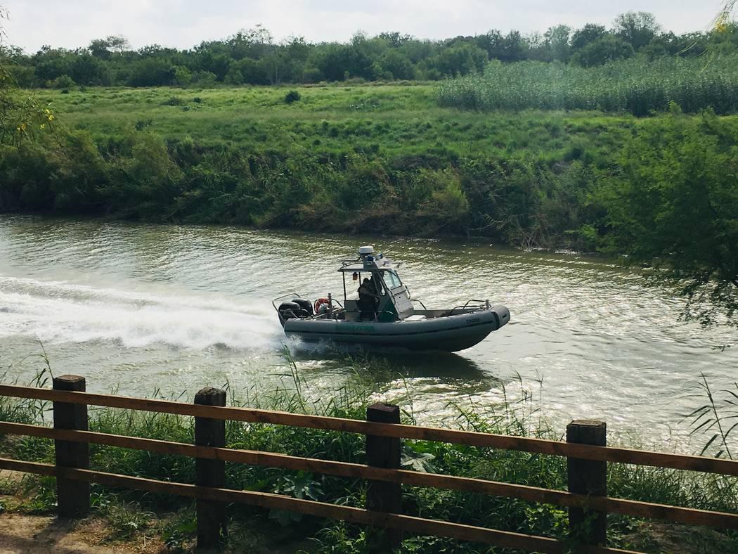 A U.S. Border Patrol boat navigates the Rio Grande near where the bodies of Salvadoran migrant ...