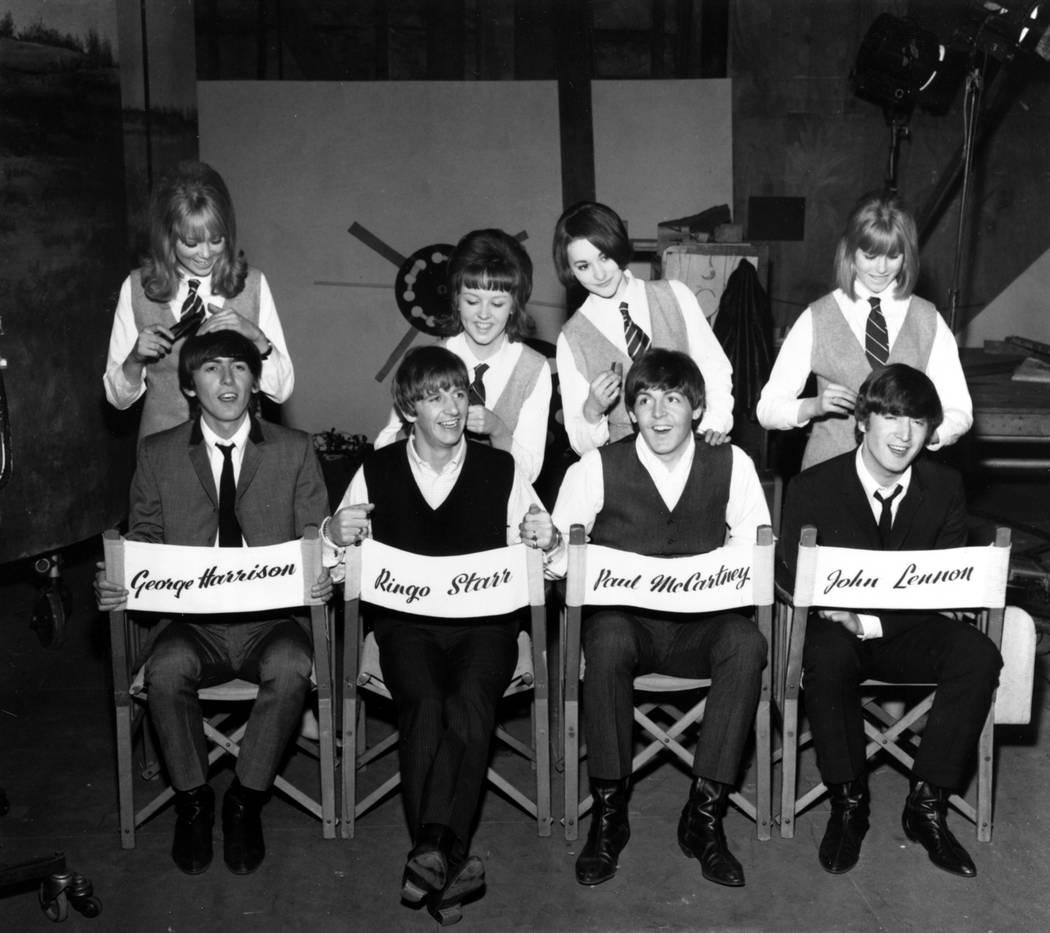 The Beatles, George Harrison, Ringo Starr, Paul McCartney and John Lennon, have their hair comb ...