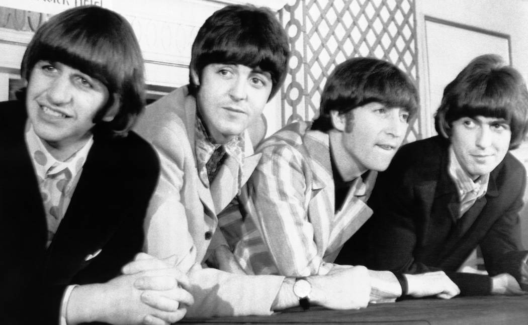 The Beatles pose for photographers during a press conference in New York on Monday, August 23, ...