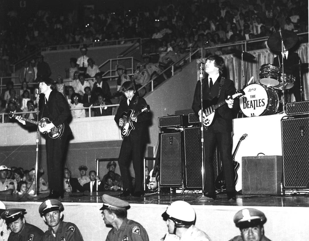 The Beatles - Paul McCartney, George Harrison, Ringo Starr and John Lennon - playing at the Con ...