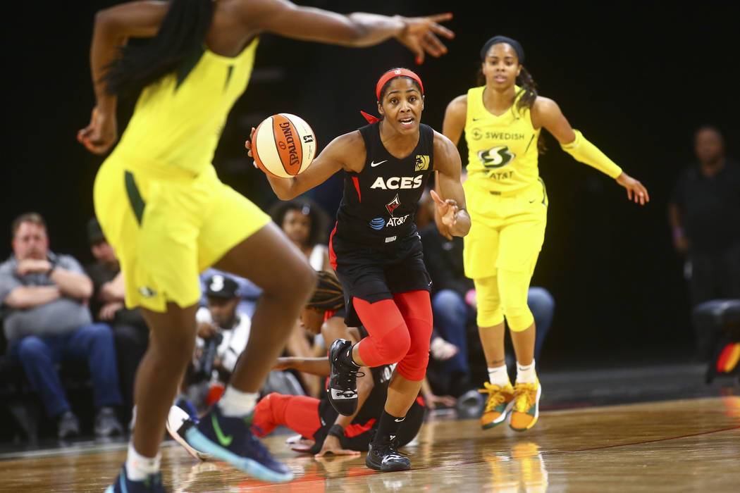 Las Vegas Aces guard Sydney Colson (51) brings the ball up court against the Seattle Storm duri ...