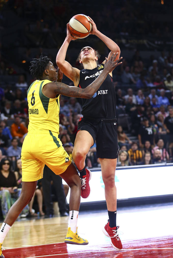 Las Vegas Aces forward Dearica Hamby (5) goes to the basket against Seattle Storm forward Natas ...
