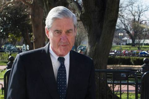 FILE - In this March 24, 2019 photo, then-special counsel Robert Mueller walks past the White H ...