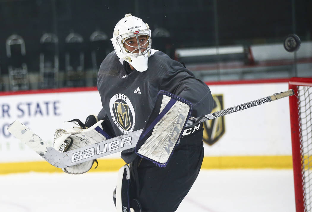 Golden Knights prospect Isaiah Saville defends the net during the first day of development camp ...