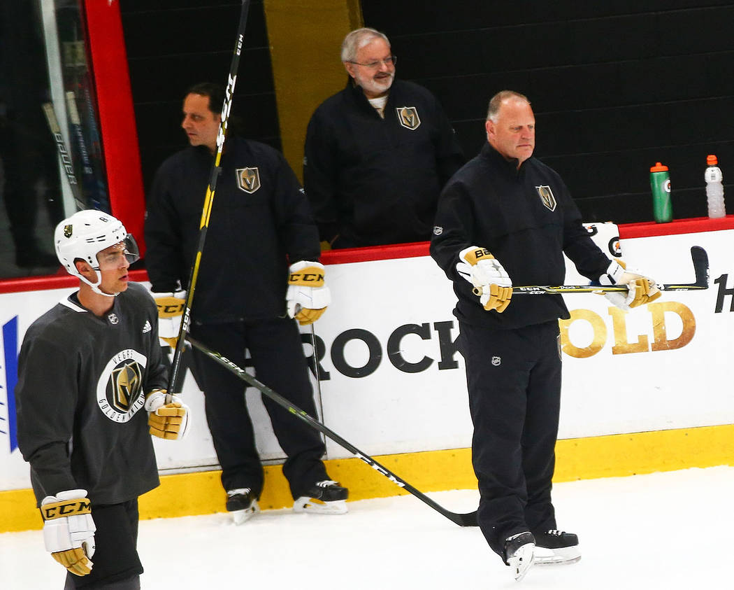 Golden Knights head coach Gerard Gallant, center left, watches prospects during the first day o ...