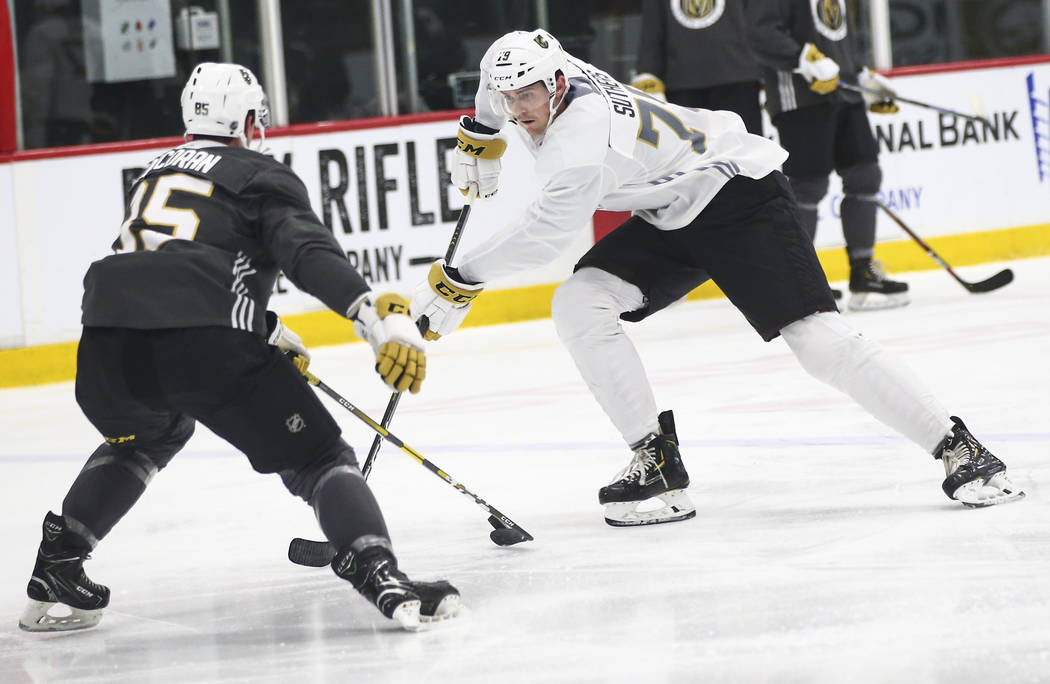 Golden Knights prospect Keenan Suthers skates with the puck against Connor Corcoran during the ...