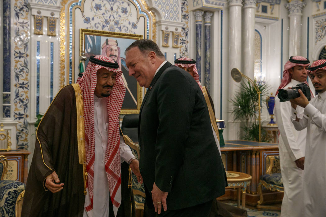 Secretary of State Mike Pompeo leans in to greet Saudi Arabia's King Salman during their meetin ...