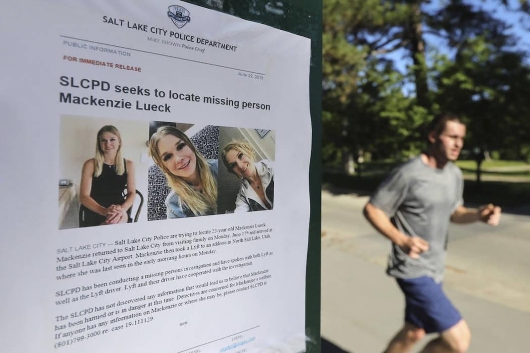 A joggers runs pass a poster of MacKenzie Lueck at Liberty Park Monday, June 24, 2019, in Salt ...