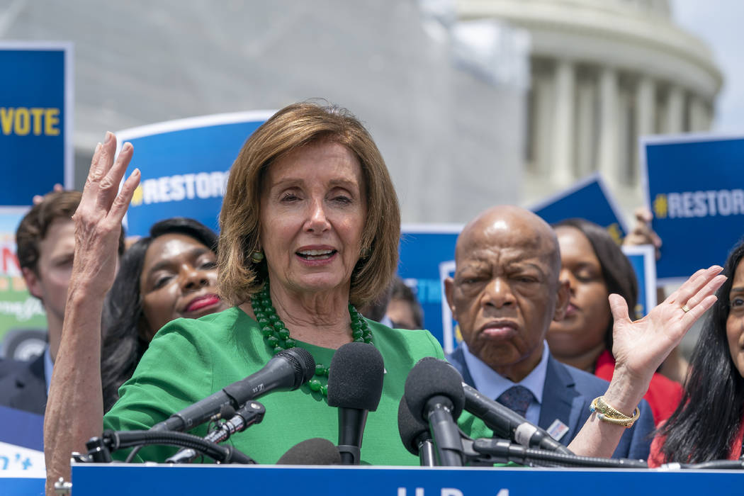 Speaker of the House Nancy Pelosi, D-Calif., flanked by Rep. Terri Sewell, D-Ala., left, and Re ...