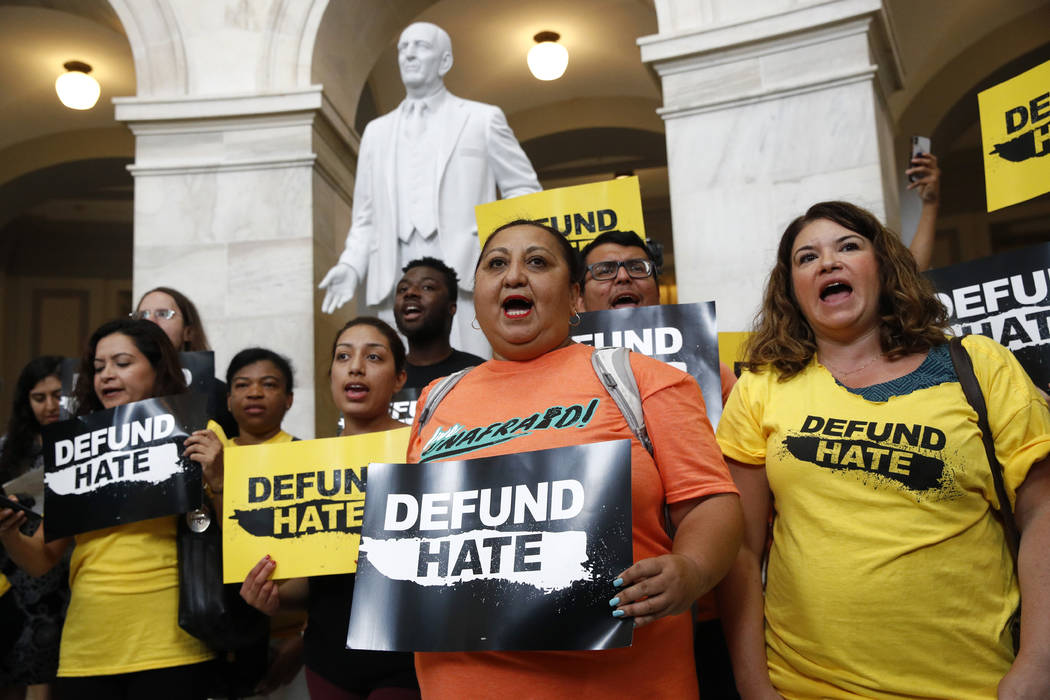 Protesters gather to demand the defunding of government agencies for border protection and cust ...