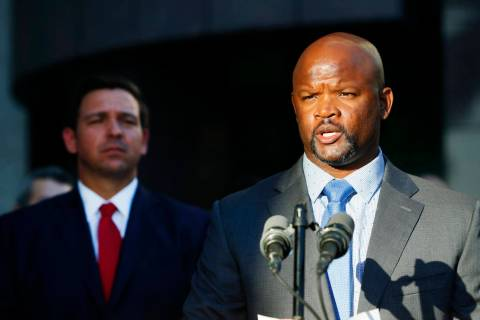 FILE - In this Jan. 11, 2019 file photo, acting Broward County sheriff Gregory Tony, right, spe ...