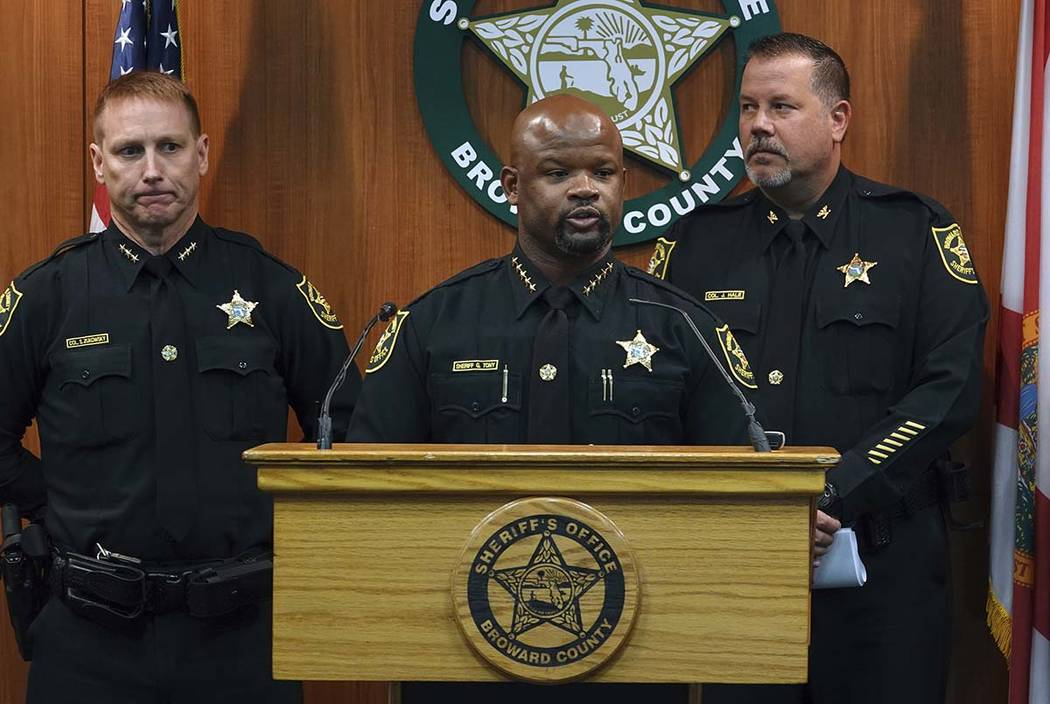 Broward Sheriff Gregory Tony, center, announces that two additional deputies have been fired as ...