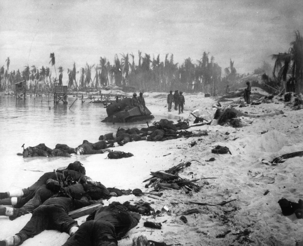FILE - In this Nov. 1943 file photo, sprawled bodies are seen on the beach of Tarawa atoll test ...