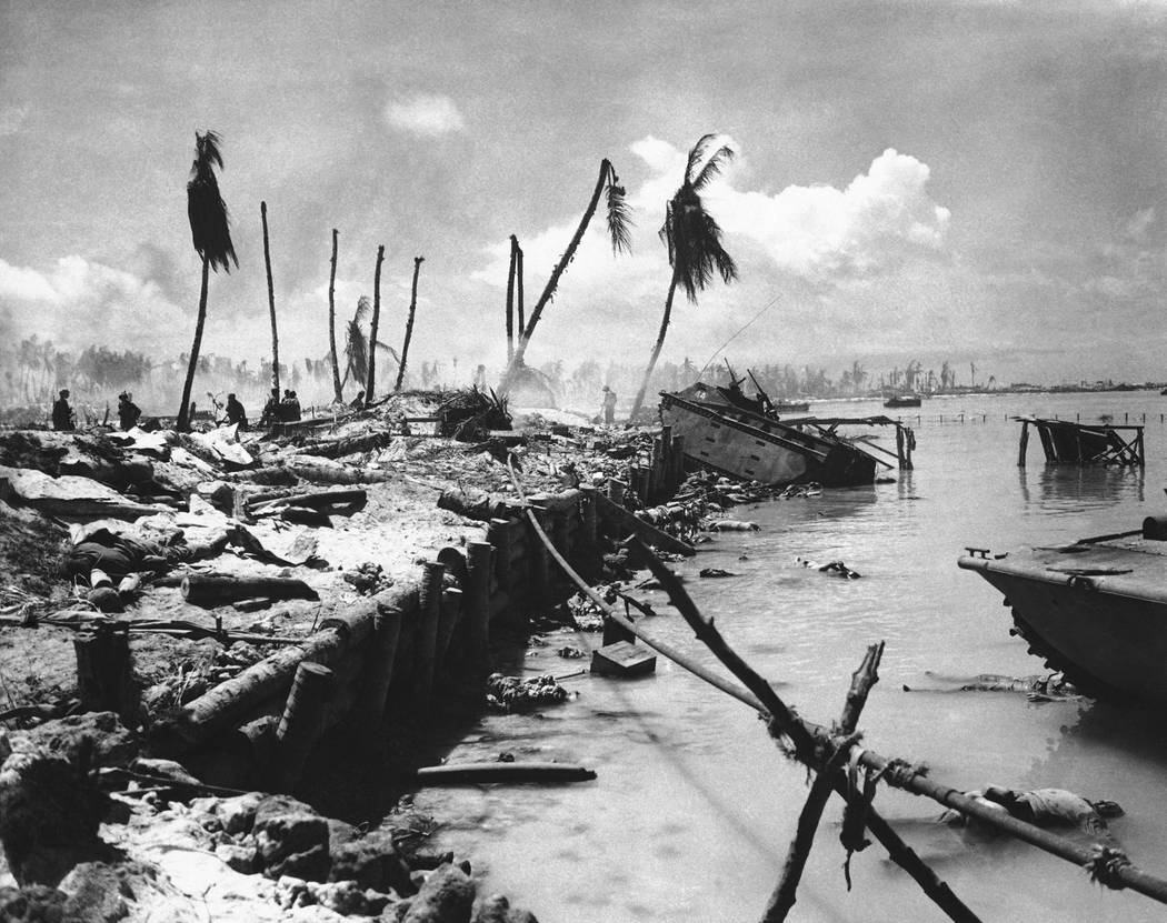 FILE - In this November 1943 file photo, bodies and wrecked amphibious tractors litter a battle ...