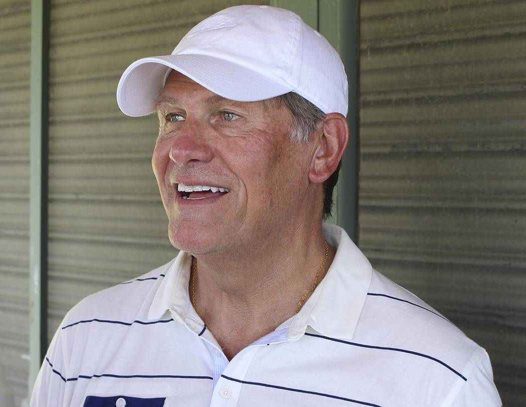 Connecticut women's basketball coach Geno Auriemma speaks to reporters during his charity golf ...